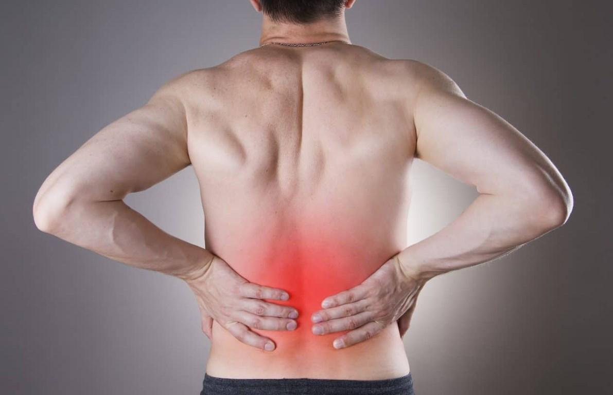 Спина болит внизу
